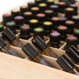 Wooden essential oil storage box.  Holds 68 bottles including rollers.