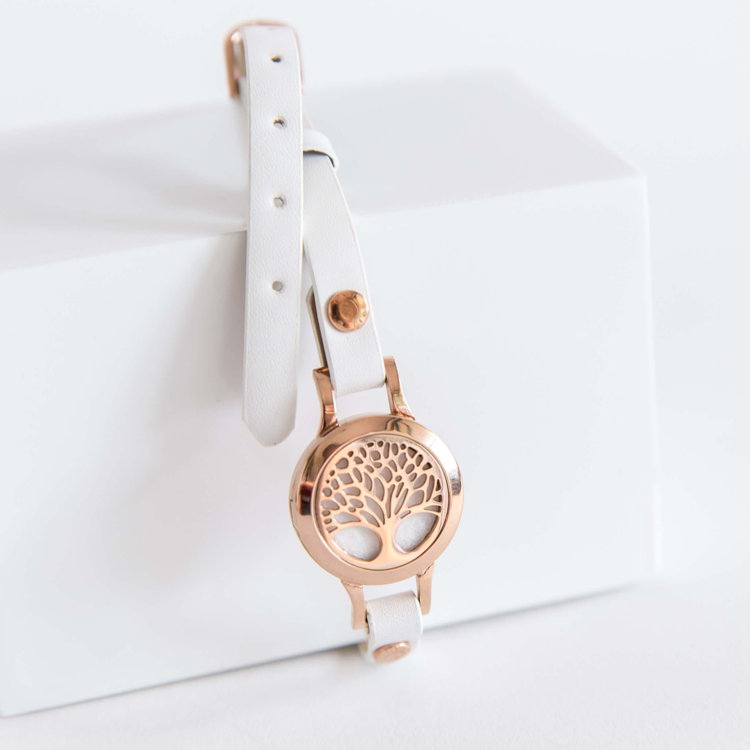 rose gold essential oil diffuser bracelet.  White leather strap aromatherapy jewellery.