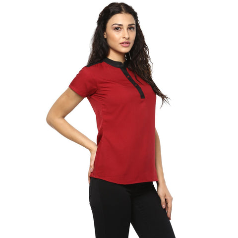 Red and black woven top in a colourblock