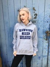 photo of stranger things hoodie with hawkins high print