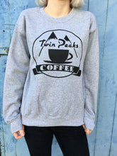 photo of twin peaks coffee design on grey jumper
