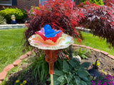 Repurposed Garden Yard Bottle Art with Cranberry Guitar Bottle, Egg Plate & Glass Blue Bird