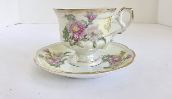 Vintage Inarco E3007 Iridescent Purple Flower Footed Teacup with Matching Saucer - Nature Land Candles