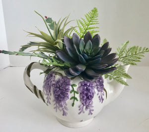 Floral Arrangement with Green Grass Succulents in a Purple Grapes Teapot - Nature Land Candles