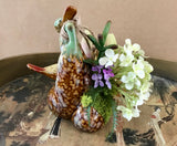 Decorative Planter with White Flowers and Green Grass Succulents in a Ceramic Planter with Birds - Nature Land Candles