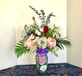 Floral Arrangement Centerpiece with Multi-Colored Silk Flowers in a Blue Floral Vase