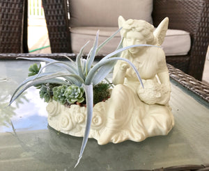 Decorative Ceramic White Seated Angel with Flower Basket in Hand Planter with Green Grass Succulents - Nature Land Candles