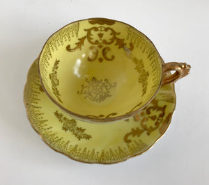 Vintage Royal Sealy Yellow and Gold Iridescent Footed Teacup and Saucer