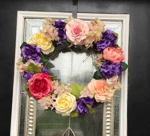 Door Wreath with Artificial Yellow and Pink Roses on a bed of Green Leaves - Nature Land Candles