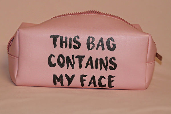"""This Bag Contains My Face"" Makeup Bag in Pink"