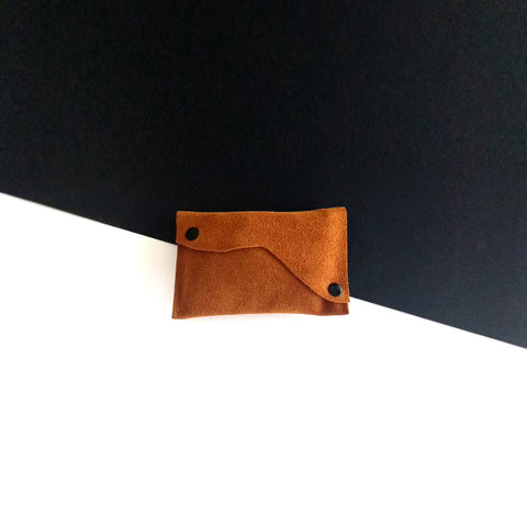 Brown suede leather case with cloudy shape flap.