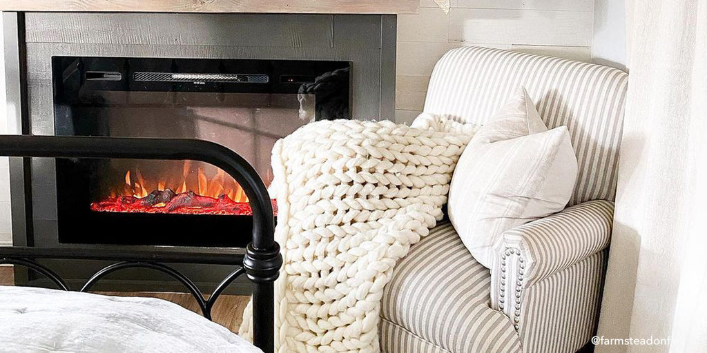 The Touchstone Forte Electric Fireplace adds an upscale look to any guest room