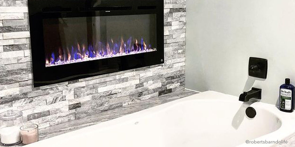 Touchstone Sideline Electric Fireplace in farmhouse barn style bathroom with stone tile