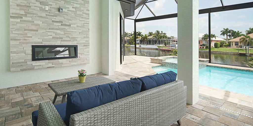 Outdoor Electric Fireplace on a patio in a covered pool area