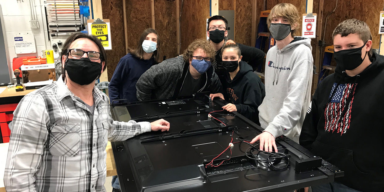 BOCES2 technical students install a Touchstone SRV TV lift in the classroom.