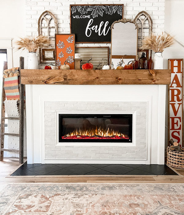 Finished DIY fireplace project by @redbrickfauxfarmhouse featuring Touchstone Sideline Elite 50 Electric Fireplace