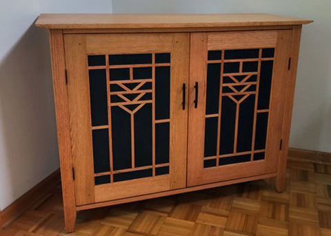 Whisper Lift TV Lift in the down position in Arts and Crafts custom built cabinet