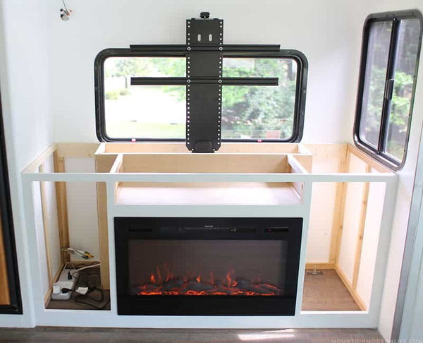 Mountain Modern Life RV Renovation with Touchstone TV Lift and Sideline 36 Electric Fireplace.