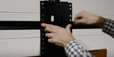 Attach the TV mounting brackets and TV to the WhisperLift II TV lift mechanism.