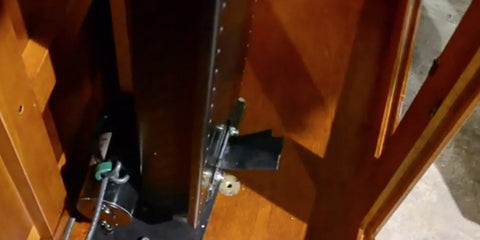 The Touchstone Whisper Lift II TV Lift mechanism mounted to the the base of the cabinet.