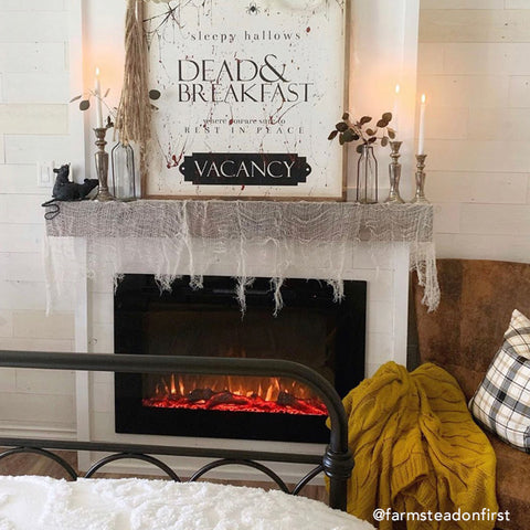 The Forte Electric Fireplace, inserted in a farmhouse style mantel decorated for Halloween by @farmsteadonfirst