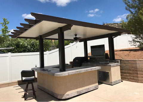 Outdoor entertainment area with Touchstone TV lift mechanism