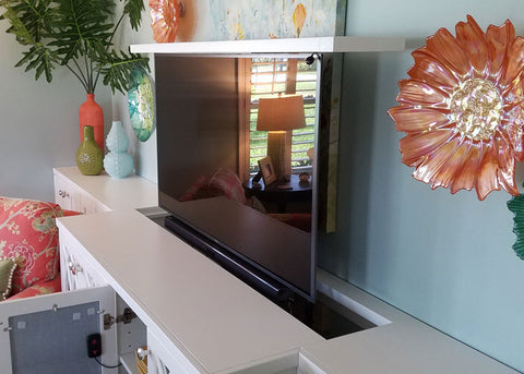 The Touchstone Whisper Lift TV lift mechanism with the flat top lift mount in a custom built cabinet