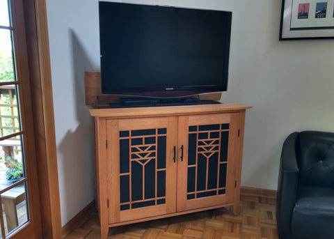 Whisper Lift TV Lift in a custom built arts and crafts style cabinet