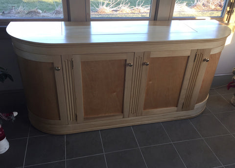Custom built curved TV lift cabinet featuring Touchstone Whisper Lift