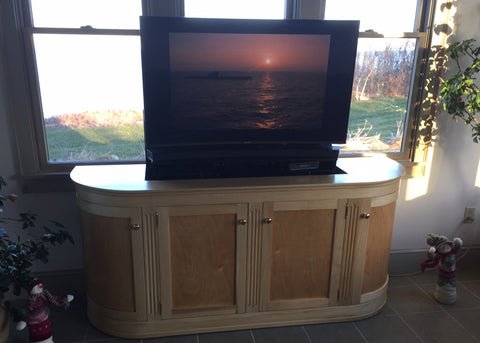 Whisper Lift TV Lift in a custom curved TV lift cabinet