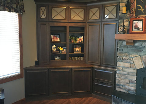 The Whisper Lift II lowers the TV into the cabinet so the shelves are in full view.