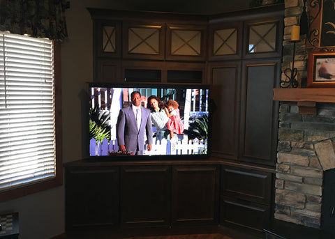 Whisper Lift II TV Lift Mechanism This custom TV lift cabinet is the cornerstone of the room