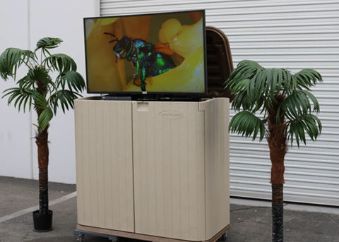 Whisper Lift TV lift in an outdoor storage chest