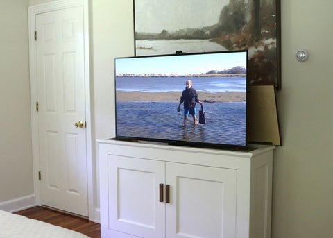 Custom built cabinet by Jon Peters Art & Home with Touchstone Whisper Lift TV Lift