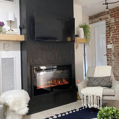 Black tile fireplace wall with Touchstone Sideline Electric Fireplace by madelineinthegarden