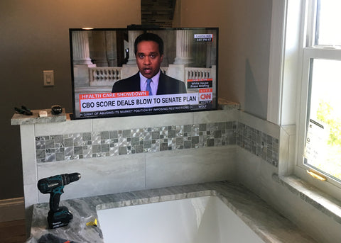 The Touchstone SlimLift Pro fits nicely in the tiled half wall for TV viewing from the bath.