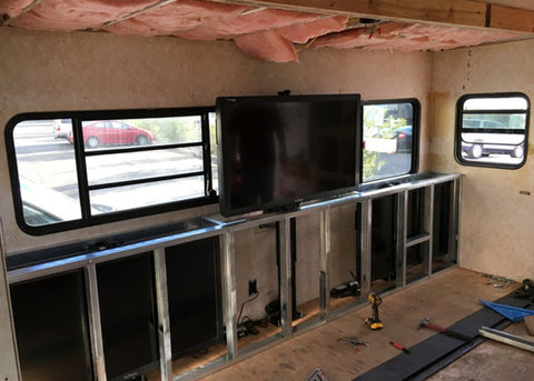 Whisper Lift TV lift built into a TV production trailer