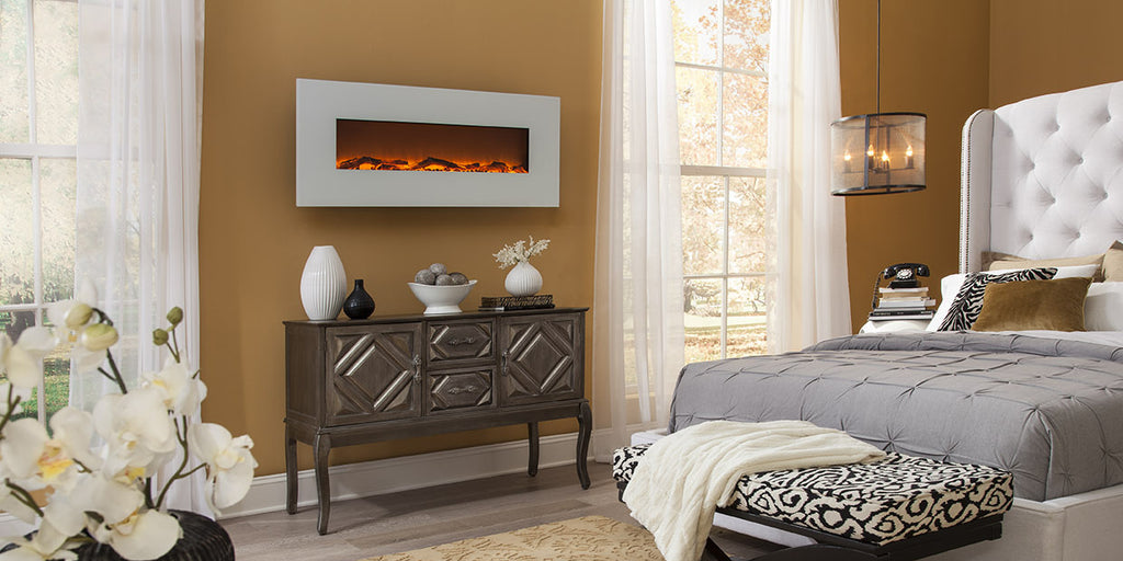 The Touchstone Ivory Wall Mount Electric Fireplace is easy to hang on the wall above a dresser