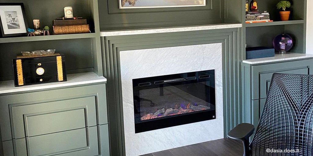 Touchstone Sideline Electric Fireplace in home office with built in, paneled green shelves