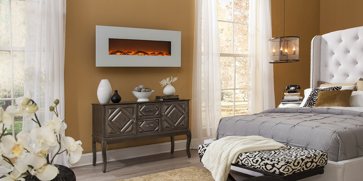 Touchstone Ivory Wall Hanging Electric Fireplace mounted to a bedroom wall