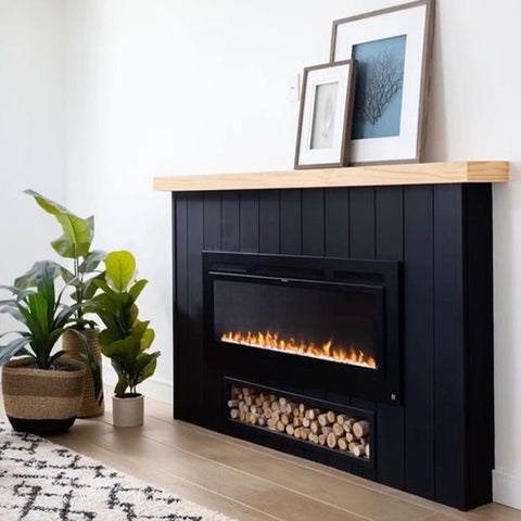 Black panel fireplace mantel with Touchstone Sideline Electric Fireplace by haleydoeshouses