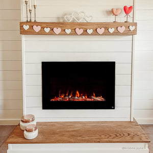 Touchstone Forte 80006 Electric Fireplace recessed in shiplap wall