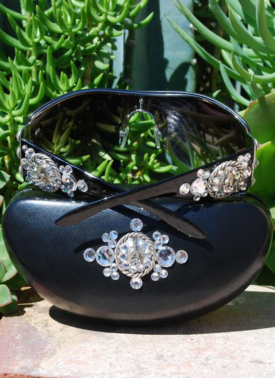 black sunglasses with clear rhinestones and metal concho with guitar
