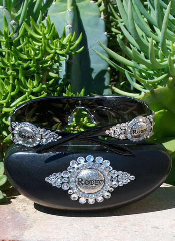 Rodeo cowgirl sunglasses black frame sunglasses with clear crystals metal concho that say Rodeo