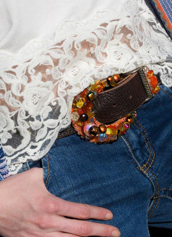 orange dichroic buckle with orange handblown glass goblets on a buckle with a brown belt studed with fire opal swarovski crsytals