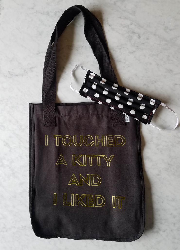 Black screen printed tote bag and black and white face mask