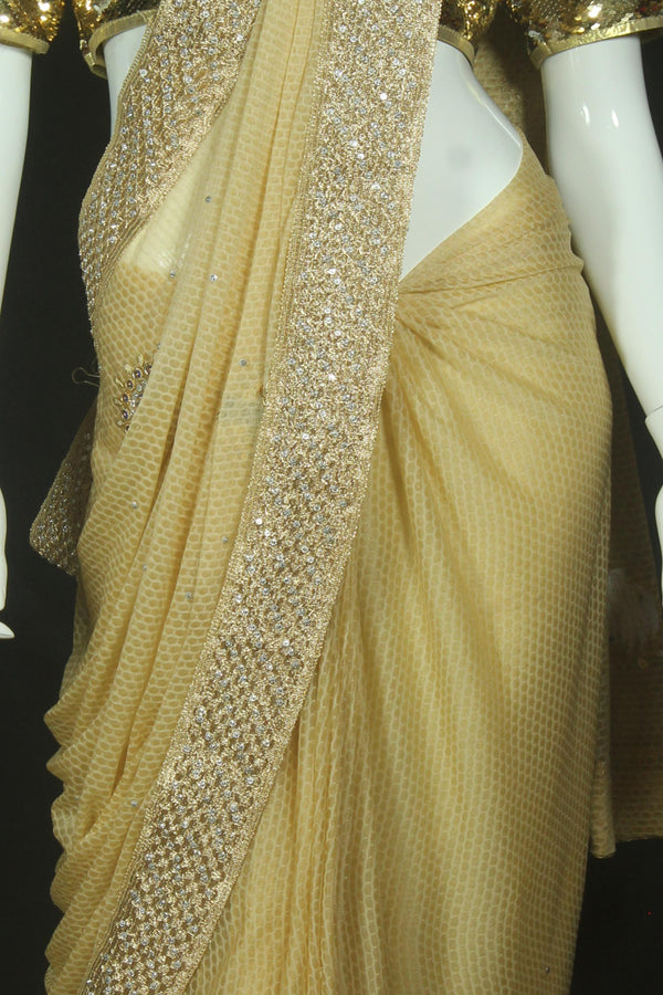 Golden Saree with heavy embroidery
