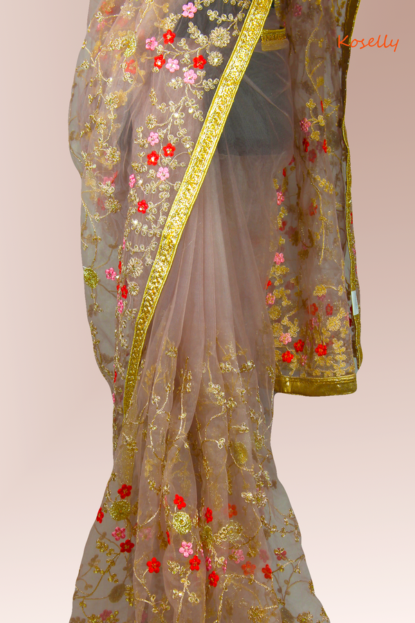 Pink net embroidered saree