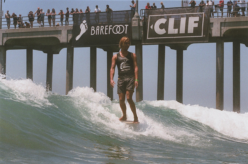 Alex Knost longboarding in the Joel Tudor Duct Tape Invitational in Huntington Beach at Vans US Open of Surfing.