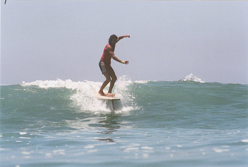 Andy Nieblas longboarding in the Joel Tudor Duct Tape Invitational in Huntington Beach at Vans US Open of Surfing.